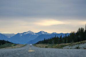 Lone car on Alaskan highway